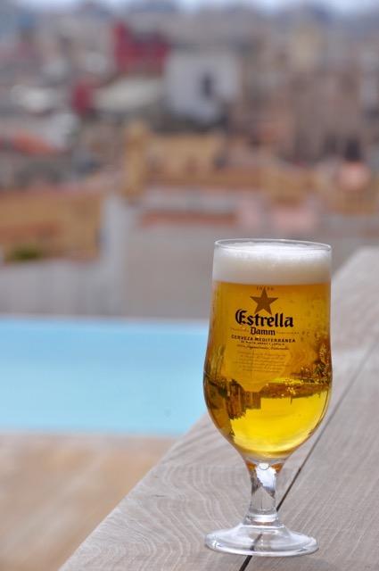 Estrella: Golden and cold, served in small glasses.